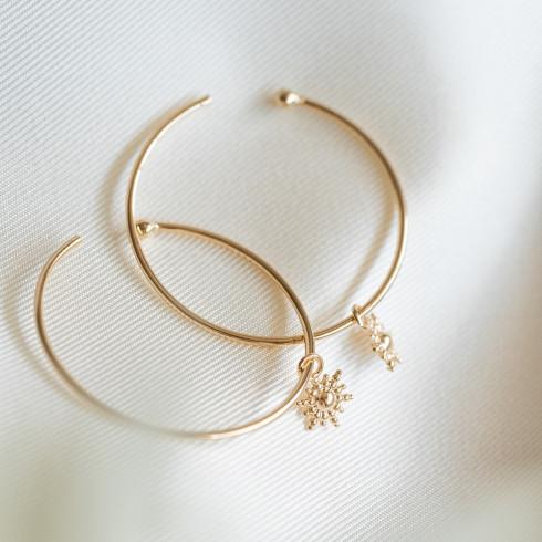 Boucles d'oreilles créoles en plaqué or soleil