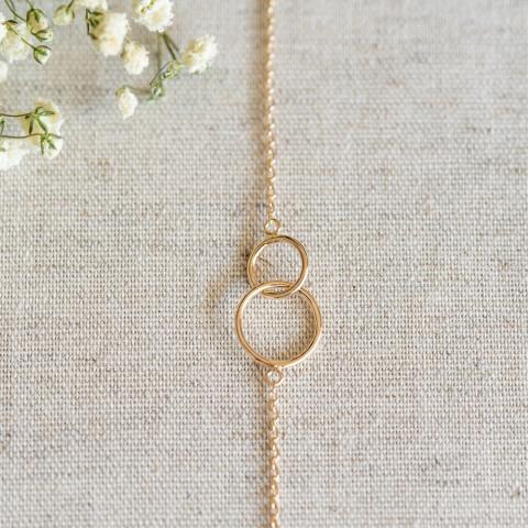 Bracelet fin plaqué or 2 anneaux entrelacés libres cercles