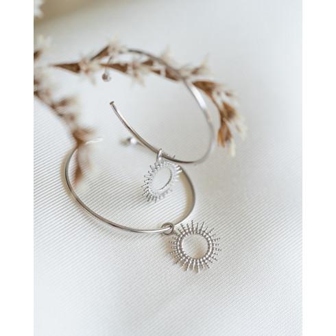 Boucles d'oreilles créoles en argent rhodié avec petits rayons de soleil